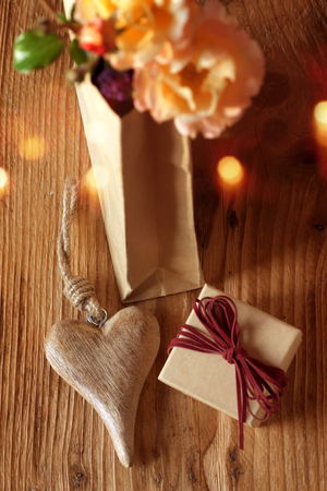 Gifts handmade with a heart and flowers on a wooden table for christmas