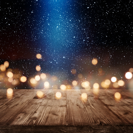 Christmas background with golden bokeh and blue light beam for a presentation Standard-Bild