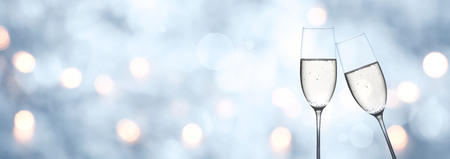 Abstract blue winter background with champagne and golden bokeh for a new year