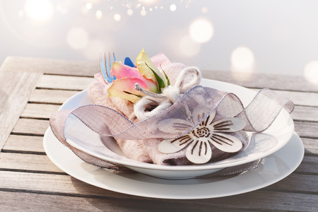 Beautiful mothers day table decoration in vintage style with golden bokeh 写真素材