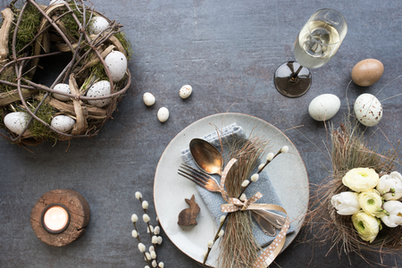 Table decoration with champagne for a festive easter dinner Stock Photo