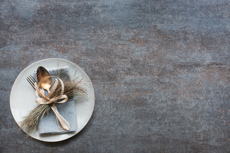 Plate with old silver cutlery beautifully arranged on a gray ceramic stone plate for a background Reklamní fotografie