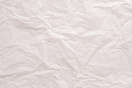 Bright pink crumpled paper background top view