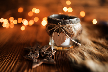 Christmas decoration in country house style on rustic wooden table and golden bokeh
