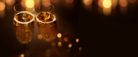 Festive bokeh background with champagne glasses to celebrate