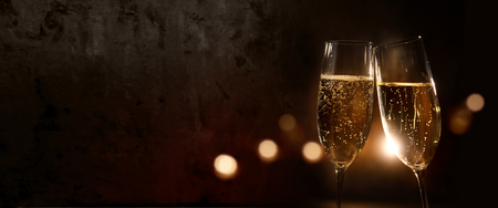 Dark bokeh background with champagne glasses for a new year celebration