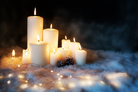 Christmas decoration with burning candles in a cold winter night