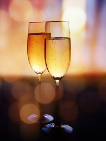 Two champagne glasses to celebrate on a festive bokeh background for new year congratulations Stock fotó