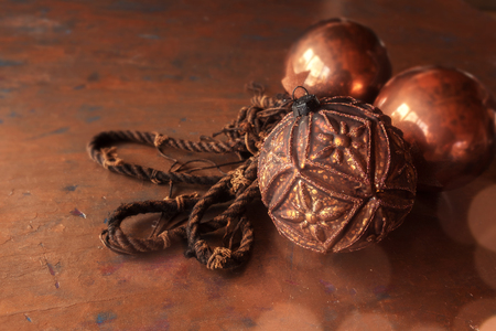 Still life with christmas balls in copper color on a festive background Stock Photo
