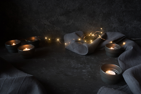 Dark halloween decoration with lights on black stone for a background