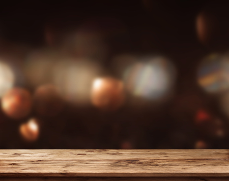 Old rustic wooden table with abstract dark bokeh background for decorations