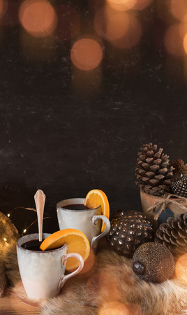 Cozy christmas time with golden bokeh and a hot drink