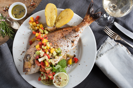 Fried fish with herbs filling and vegetables for a christmas dinner Imagens
