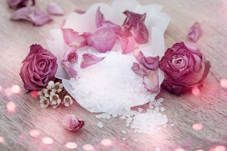 Wellbeing with aroma salt and pink roses for a wellness treatment