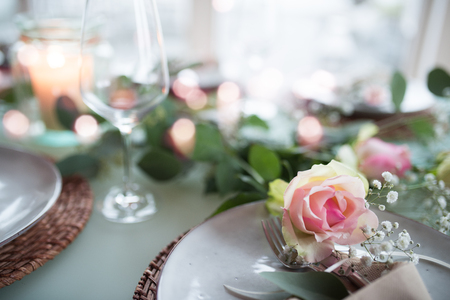 Romantic festive table decoration for a wedding celebration with bokeh and short depth of field