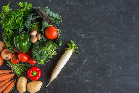 Healthy vegetables on dark gray stone plate Stock Photo