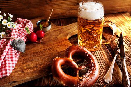 Bavarian specialties with fresh beer and salt pretzel on rustic wood Reklamní fotografie