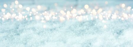 Cold blue winter background with bright bokeh for a christmas decoration Banco de Imagens