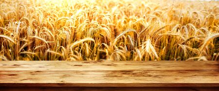 Golden wheat field with empty old wooden table for a decoration Stock fotó
