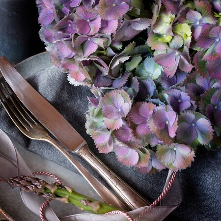 Romantic table setting with hydrangeas in vintage style