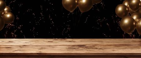 Wooden table with fireworks and golden ballons on night sky for a celebrations background