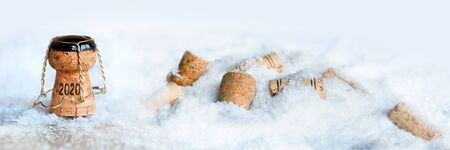 Champagne corks in snow at the turn of the year 2020