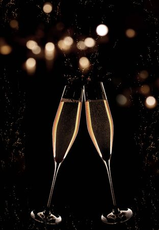 Vertical dark background with golden champagne and luminous bokeh at the turn of the year