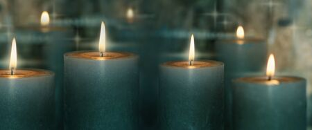 Candlelight with reflection on dark background Stock Photo