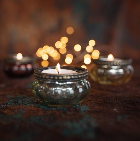 Atmospheric christmas candlelight with golden bokeh