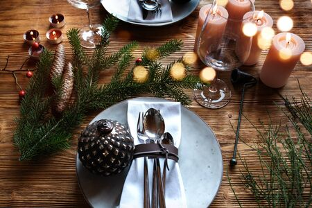 Festive table decoration for christmas with golden bokeh for a background Stock Photo