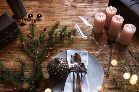 Table decoration with festive golden bokeh for christmas