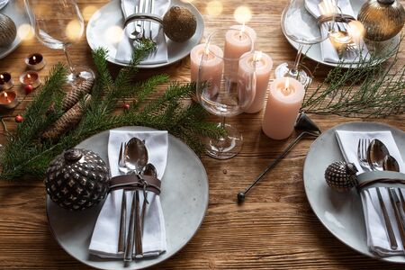 Modern table decoration for christmas with golden bokeh for a dinner