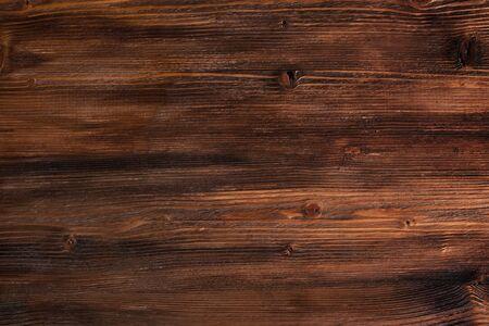 Dark textured reddish wood background for a decoration Foto de archivo