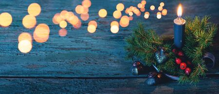 Festive blue background with candle and ornaments for a christmas card Reklamní fotografie