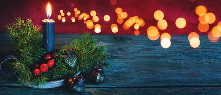 Festive background with candle and ornaments for a christmas card Stok Fotoğraf