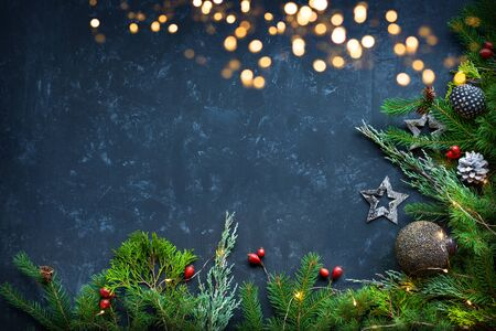 Festive christmas decoration on blue background with copy space