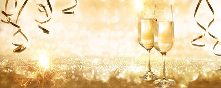 Golden sparkling new years eve background with champagne and streamers for a concept