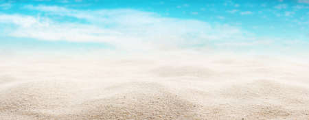 White sandy beach with a sea view. Close-up with short depth of field and space for text. Background for a tourism concept or summer vacation and travel.