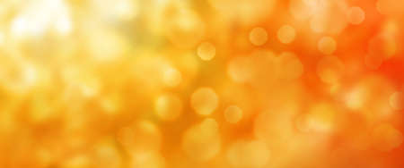 Abstract orange golden bokeh texture. Horizontal background for a seasonal concept design with space for text. Stock Photo