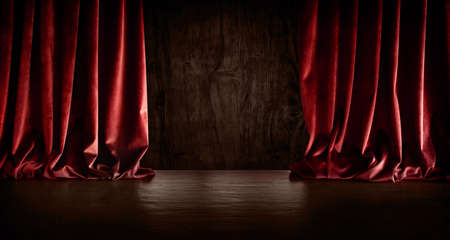 Dark empty stage scene with red velvet curtain. Horizontal background for anniversaries, birthdays, concerts, shows and special occasions. Space for text.