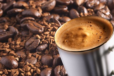 coffeebeans: Cup of coffee over coffee-beans and instant coffee background