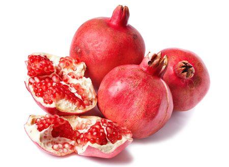 Colorful pomegranates isolated on white