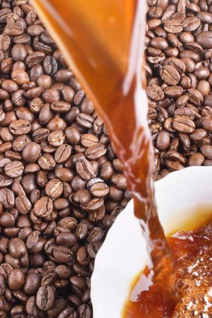 coffeebeans: Pouring coffee and coffee-beans  Stock Photo