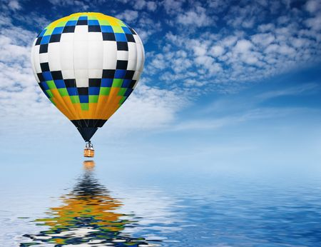 untroubled: Hot air balloon flying in blue sky