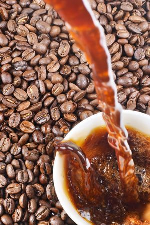 Pouring coffee and coffee-beans  Stock Photo