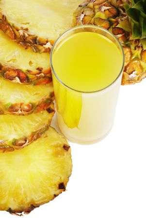 Glass of pineapple juice and pineapple slices isolated on white
