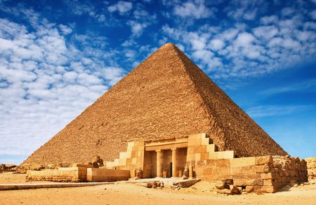 tremendous: Ancient egyptian pyramid against blue sky