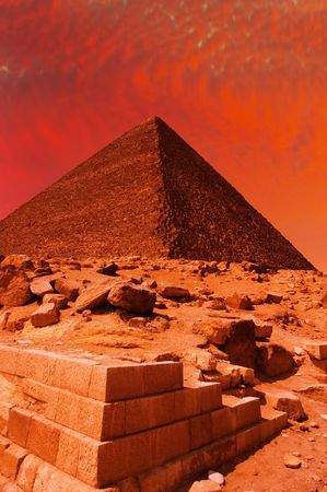 Ancient egyptian pyramid at red sunset photo
