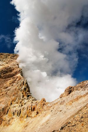 volcanic: Gases cloud over volcanic crater.