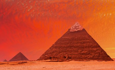 Ancient egyptian pyramids at red sunset photo